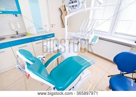 Professional Dentist Tools And Chair In The Dental Office. Dental Hygiene And Health Conceptual Imag