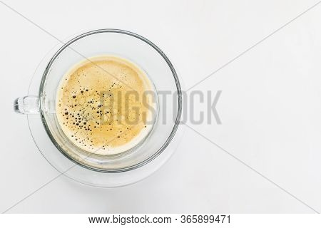 Full Cup Of Fresh Espresso, View From Above. Cup Of Fresh Espresso In Glass Cup On White Background.