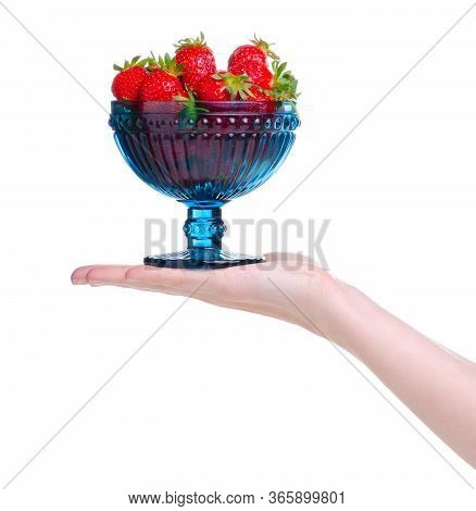Strawberries In Dessert Plate In Hand On White Background Isolation