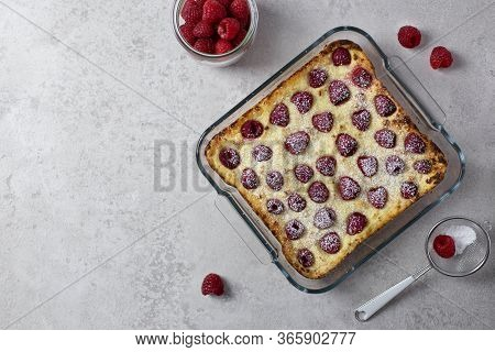 Homemade Casserole With Cottage Cheese, Semolina And Raspberries. Sweet Cake With Icing Sugar. Top V