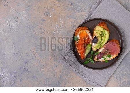 Bruschetta With Salmon. Bruschetta With Tuna. Bruschetta With Red Fish. Small Seafood Sandwiches