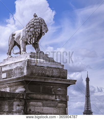 Paris, France - One Of The Two Marble Lions Of The Tuileries Garden Overhanging The Concorde Place A