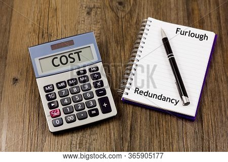 Furlough And Redundancy Concept - With Calculator And The Word Cost