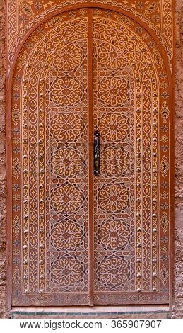 Decorated Ancient Door In Marrakesh, Morocco. Islamic Patterns And Ornaments On Painted Wooden Door.