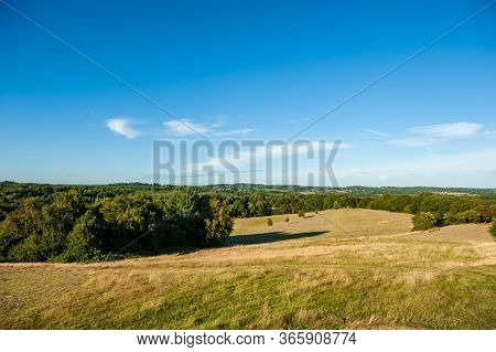 Fields And Meadows Around Herstmonceux, East Sussex, England. Brick Herstmonceux Castle In England (