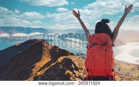 Young Asian Women Hikers Climbing Up On The Peak Of Mountain Near Ocean. Woman Hiking In The Mountai