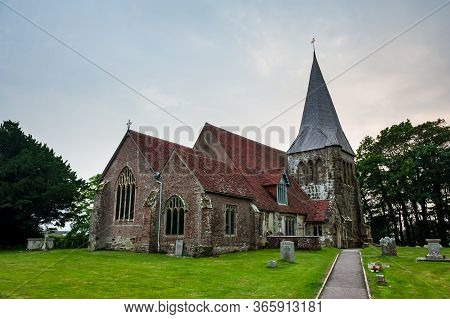 All Saints Church In Herstmonceux, East Sussex, England. Brick Herstmonceux Castle In England (east