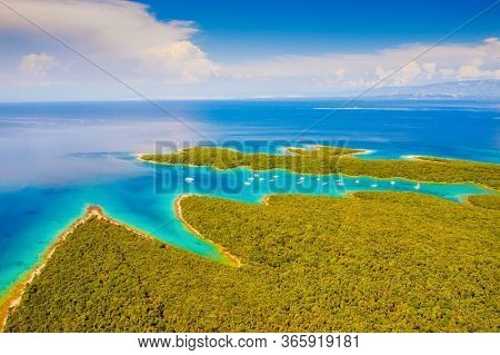 Great aerial view of the azure lagoon on sunny day. Location Kvarner Gulf, Punta Kriza, Cres island, Croatia, Europe. Drone photography of popular tourist destination. Discover the beauty of earth.