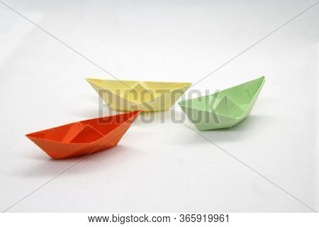 Paper Boats In Various Colors. Colorful Paper Boats On A White Background.