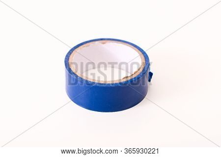 Insulating Tape Isolated On A White Background, Blue Spool Of Adhesive Electrical Tape. Insulating T