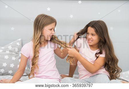 Unhand My Hair. Naughty Children Pull On Hair. Beauty Look Of Little Girls. Hair Salon. Home Clothin
