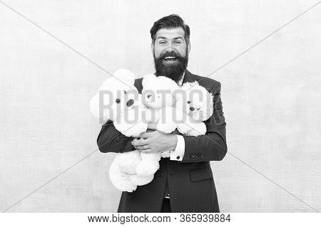 Adoption Is Wonderful Thing. Happy Man Hold Soft Toys. Businessman Dream Of Children. Adoptive Paren