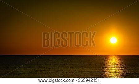 Sunrise Over Sea. Sun Rising Above Horizon.