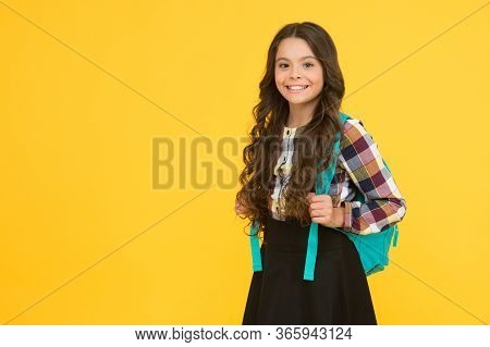 Welcome Back. Happy Child Go To School Yellow Background. Little Girl In School Uniform. Back To Lea