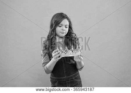 Real Values. Kid Hold Golden Crown Symbol Of Princess. Girl Cute Baby Looking At Crown Turquoise Bac