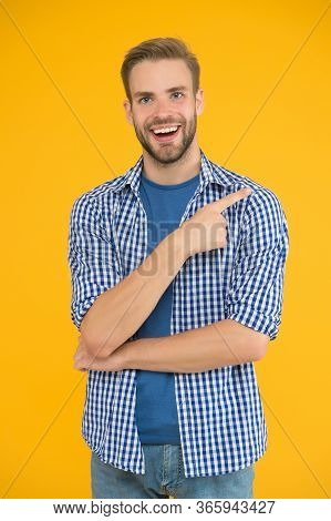 Choose This. Happy Man Pointing Index Finger. Pointing Gesture And Gesturing. Pointing For Advertisi