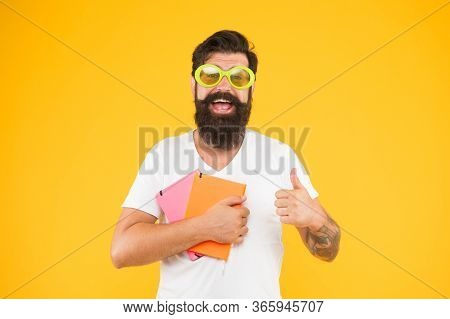I Recommend It. Happy Man In Glasses With Notebook. Graduate From University. Back To School. Mature