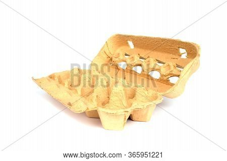 Empty Grass-based Egg Box Made From A Mixture Of Ryegrass, Hay And Recycled Paper Isolated On White