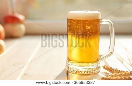 Oktoberfest Beer. Glass Beer Mugs Full Of Golden Lager With Thick Frothy Heads Conceptual Of Oktober