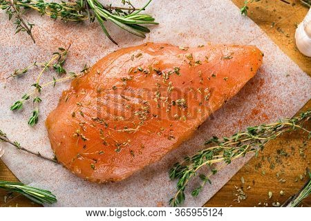 Raw Meat In The Marinade. Marinated Chicken Breast With And Rosemary. Sottilissime Raw Fillet With A
