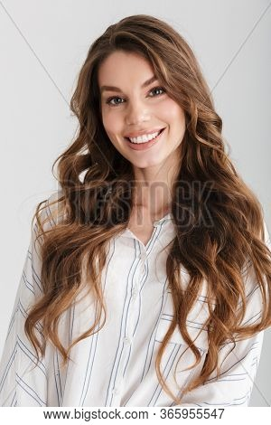 Image of happy caucasian woman smiling and looking at camera isolated over white background