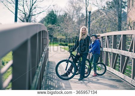 Mom With Her Two Boys, Riding Bikes, Outdoors