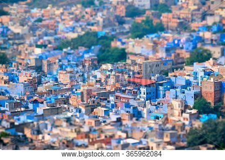 Aerial view of Jodhpur, also known as Blue City due to the vivid blue-painted Brahmin houses around Mehrangarh Fort. Jodphur, Rajasthan, India. Tilt shift miniature toy effect