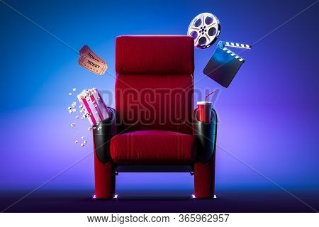 Red Cozy Cinema Armchair With Comfortable Elbows Near Popcorn Bowl, Tickets, Film Reel And Movie Cla