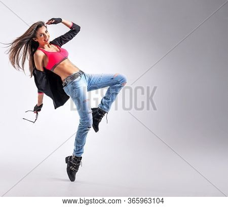 Beautiful young fit modern dancer lady