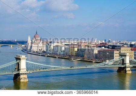 Skyline Panorama Of Budapest, Chain Bridge, Hungarian Parliament And Houses.