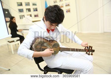 Tar String Instrument . Man Playing On A Classical Folk Instrument Tar Of Azerbaijan. A Musician Pla