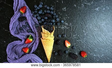 Summer Blueberries And Blackberries In Ice Cream Waffle Cone