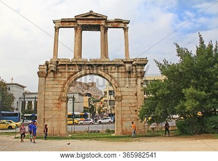 Athens, Attica, Greece - October 18, 2018:  Tourists Walking Around Hadrian's Arch With Acropolis Hi