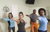 Group of multi ethnic people practicing yoga poster