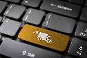 Transport delivery key with truck icon on laptop keyboard. Included clipping path so you can easily edit it. poster