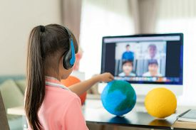 Asian Girl Student Live Learning Video Conference With Teacher And Other Classmates Giving Presentat