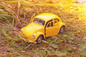 Izhevsk, Russia, September 14, 2019. Retro Car Toy In Autumn Forest. Yellow Car In Autumn Landscape.