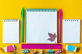 School Stationery On A Yellow Background. Concept Hello September Or Back To School. School Supplies