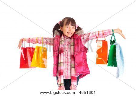 Chica con bolsas