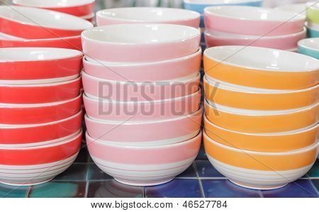 Stacks Of Colorful Cups In Warehouse