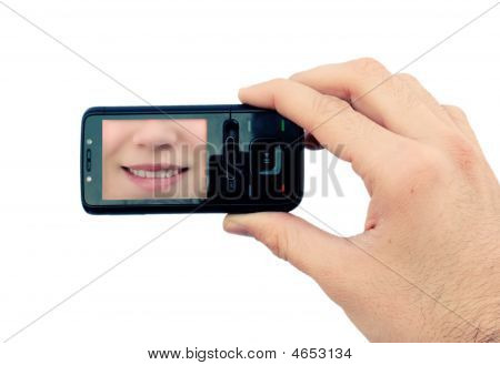 Hand With Mobile Phone And Smile