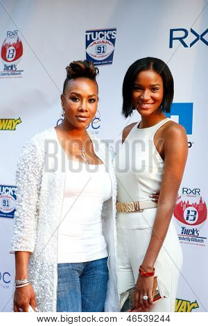NEW YORK-MAY 30: Actress Vivica A. Fox (L) attends the 5th annual Tuck's Celebrity Billiards Tournament at Slate NYC on May 30, 2013 in New York City.