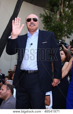 LOS ANGELES - MAY 31:  Dr. Phil McGraw at the David Foster Hollywood Walk of Fame Star Ceremony at the Capital Records Building on May 31, 2013 in Los Angeles, CA