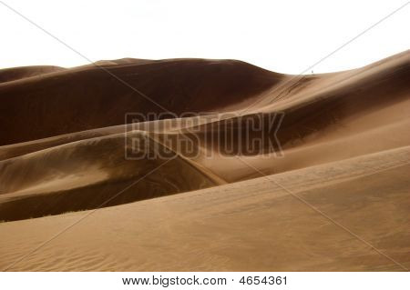 poster of People small like aints walking far-away in dunes with sand being blown over by wind