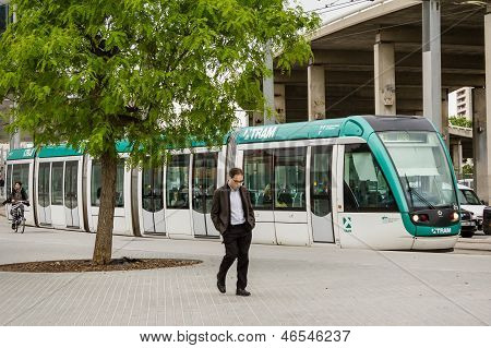 Sleepy Man Walking In The Morning To The Work And A Tram Stopped Behind, In Barcelona, Spain