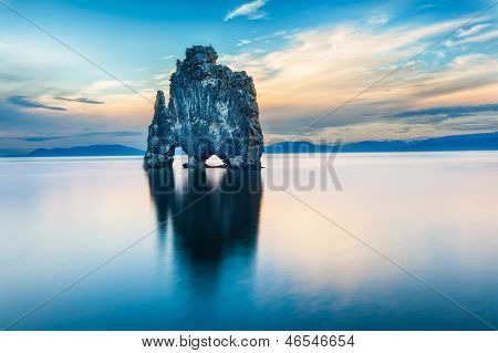 Hvitserkur is a spectacular rock in the sea on the Northern coast of Iceland. Legends say it is a petrified troll. On this photo Hvitserkur reflects in the sea water after the midnight sunset. poster