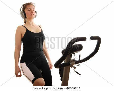 Woman Listening Music On Bicycle