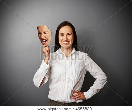 smiley woman holding mad mask