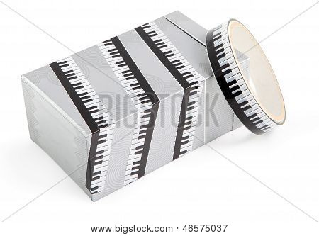 A box wrapped in decorative adhesive packaging tape with print piano. Adhesive tape with a black and white print used for packing gifts. poster