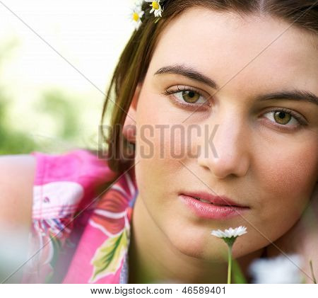 Portrait Of A Young Caucasian Woman Outdoors With Flower